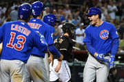 Anthony Rizzo #44, Starlin Castro #13, Kris Bryant #17 and Dexter Fowler #24 of the Chicago Cubs celebrate a three run home run during the ninth inning against the Arizona Diamondbacks at Chase Field on May 23, 2015 in Phoenix, Arizona. Cubs won 9-6.