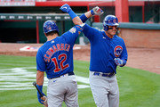 Anthony Rizzo #44 of the Chicago Cubs is congratulated by Kyle Schwarber #12 after hitting a solo home run during the sixth inning of the game against the Cincinnati Reds at Great American Ball Park on August 29, 2020 in Cincinnati, Ohio.