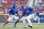 Anthony Rizzo #44 of the Chicago Cubs fields a bunt in front of Tyler Chatwood #21 in the second inning of the game against the Cincinnati Reds at Great American Ball Park on April 2, 2018 in Cincinnati, Ohio. The Reds won 1-0.