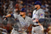 This image has been created  using camera multiple exposure in camera) Jon Lester #34 of the Chicago Cubs pitches in the sixth inning during the game between the Miami Marlins and the Chicago Cubs at Marlins Park on June 24, 2017 in Miami, Florida.