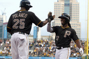 Andrew McCutchen #22 of the Pittsburgh Pirates celebrates with Gregory Polanco #25 after hitting a home run in the third inning against the Chicago Cubs during the game at PNC Park on June 10, 2014 in Pittsburgh, Pennsylvania.