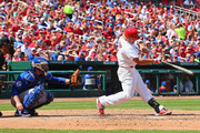 Matt Holliday #7 of the St. Louis Cardinals hits an RBI double in the fifth inning against the Chicago Cubs at Busch Stadium on August 31, 2014 in St. Louis, Missouri.  The Cardinals beat the Cubs 9-6.