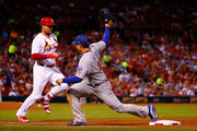 The throw to Anthony Rizzo #44 of the Chicago Cubs beats Luke Voit #40 of the St. Louis Cardinals for an out in the fifth inning at Busch Stadium on June 15, 2018 in St. Louis, Missouri.