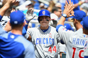 Anthony Rizzo #44 of the Chicago Cubs celebrates a  home run in the dugout in the second inning during Opening Day against Miami Marlins at Marlins Park on March 29, 2018 in Miami, Florida.