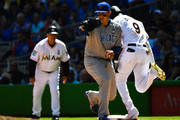 Lewis Brinson #9 of the Miami Marlins gets thrown out at first base in the sixth inning by Anthony Rizzo #44 of the Chicago Cubs during Opening Day at Marlins Park on March 29, 2018 in Miami, Florida.