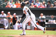 Adam Jones #10 of the Baltimore Orioles singles in Joey Rickard #23 (not pictured) in the first inning during a baseball game against the Chicago White Sox at Oriole Park at Camden Yards on September 16, 2018 in Baltimore, Maryland.