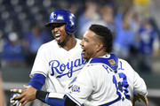 Alcides Escobar (B) of the Kansas City Royals celebrates with Salvador Perez #13  after his sacrifice bunt scored Brian Goodwin to give them a 4-3 win over the Chicago White Sox in ten innings at Kauffman Stadium on September 10, 2018 in Kansas City, Missouri.