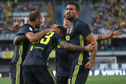 Federico Bernardeschi #33 of Juventus celebrates his goal with his team-mates Emre Can (R) and Giorgio Chiellini (L) during the serie A match between Chievo Verona and Juventus at Stadio Marc'Antonio Bentegodi on August 18, 2018 in Verona, Italy.
