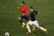 Fernando Torres of Spain and Gonzalo Jara of Chile chase the ball during the 2010 FIFA World Cup South Africa Group H match between Chile and Spain at Loftus Versfeld Stadium on June 25, 2010 in Tshwane/Pretoria, South Africa.