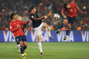 Marco Estrada of Chile and Gonzalo Jara challenge Fernando Torres of Spain during the 2010 FIFA World Cup South Africa Group H match between Chile and Spain at Loftus Versfeld Stadium on June 25, 2010 in Tshwane/Pretoria, South Africa.