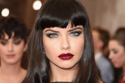 Adriana Lima's Long Wavy Cut with Bangs - The Most Gorgeous Hairstyles From Our Favorite Celebrities