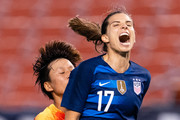 Lou Jiahui #25 of China runs into Tobin Heath #17 of the United States as Heath reacts after missing a shot during the second half at FirstEnergy Stadium on June 12, 2018 in Cleveland, Ohio. USA defeated China 2-1.