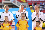 Carli Lloyd #10, Hope Solo #1 and Becky Sauerbrunn #4 of the United States look on during the nationa anthem prior to the match against China in the FIFA Women's World Cup 2015 Quarter Final match at Lansdowne Stadium on June 26, 2015 in Ottawa, Canada.