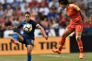 Carli Lloyd Wang Shuang Photos Photo