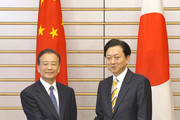 Chinese Premier Wen Jiabao (L) shakes hands with his Japanese counterpart Yukio Hatoyama prior to their talks at the latter's official residence on May 31, 2010 in Tokyo, Japan. Wen is on a three-day visit to Japan.