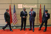 (L-R) Microsoft Founder Bill Gates, Microsoft Chairman John Thompson, Microsoft President Brad Smith and Qi Lu, executive vice president of Microsoft's Applications and Services Group, take their positions to greet Chinese President Xi Jinping at a gathering of CEOs and other executives at the main campus of Microsoft Corp. September 23, 2015  in Redmond, Washington. Xi and top executives from U.S. and Chinese companies discussed a range of issues, including trade relations, intellectual property protection, regulation transparency and clean energy, according to published reports.