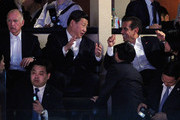 Chinese Vice President Xi Jinping (C), California Gov. Jerry Brown (L) and Los Angeles Mayor Antonio Villaraigosa (R) attend the Los Angeles Lakers and Phoenix Suns NBA basketball game at Staples Center on February 17, 2012 in Los Angeles, California. Xi wrapped up his five-day visit to the U.S. by attending the Lakers game. NOTE TO USER: User expressly acknowledges and agrees that, by downloading and/or using this Photograph, user is consenting to the terms and conditions of the Getty Images License Agreement.