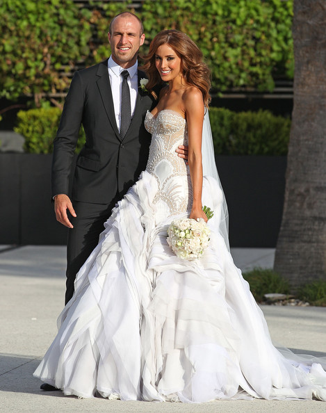 Bride Rebecca Twigley and groom Chris Judd pose after the wedding of AFL