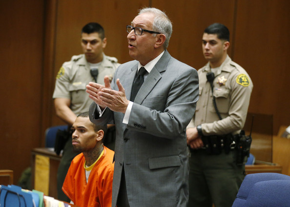 R&B singer Chris Brown (L) appears in court with his attorney Mark Geragos for a probation violation hearing during which his probation was revoked by a Los Angeles Superior judge on March 17, 2014 in Los Angeles, California. The singer was arrested March 14, 2014 and is being held without bail. Brown was first placed on probation after the 2009 domestic violence case in which he plead guilty to assaulting his then-girlfriend, singer Rihanna.