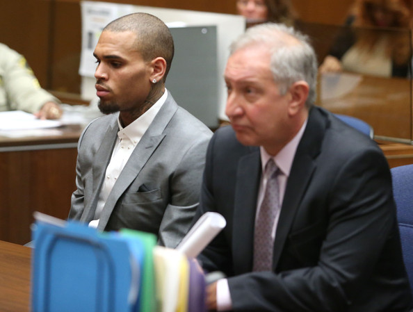 Recording artist Chris Brown (L) and his attorney appear in Los Angeles Superior Court on February 28, 2014 in Los Angeles, California.  Brown has been on probation since pleading guilty to assaulting his then girlfriend, singer Rihanna, after a pre-Grammy Awards party in 2009. He has been in anger management treatment program and performing community service requirements.  Brown and his bodyguard Christopher Hollosy are also facing misdemeanor simple assault charges after from an incident outside the W hotel in Washington D.C. last October.