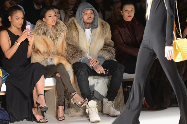 Michael Costello - Front Row - Mercedes-Benz Fashion Week Fall 2015 [fur,fur clothing,fashion,event,textile,fashion design,haute couture,fashion model,sitting,michael costello,chris brown,christina milian,karrueche tran,front row,l-r,lincoln center,new york city,mercedes-benz fashion week,fashion show]