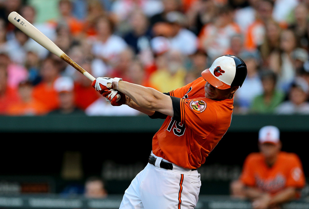 Chris Davis #19 of the Baltimore Orioles hits a three run home run in the first inning against the New York Yankees at Oriole Park at Camden Yards on June 29, 2013 in Baltimore, Maryland.