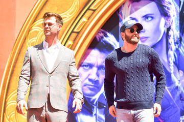Chris Evans Chris Hemsworth Marvel Studios' 'Avengers: Endgame' Cast Place Their Hand Prints In Cement At TCL Chinese Theatre IMAX Forecourt