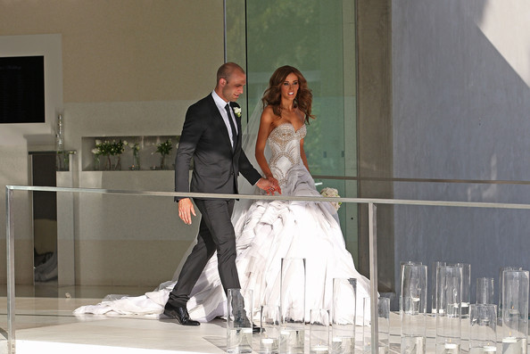 Bride Rebecca Twigley and groom Chris Judd leave after the wedding of AFL player Chris Judd and model Rebecca Twigley at Albert Park on December 31, 2010 in Melbourne, Australia.