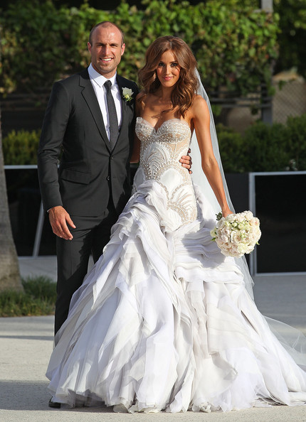 Bride Rebecca Twigley and groom Chris Judd pose after the wedding of AFL player Chris Judd and model Rebecca Twigley at Albert Park on December 31, 2010 in Melbourne, Australia.