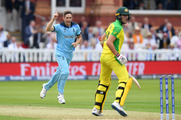 England v Australia - ICC Cricket World Cup 2019 [sports,cricketer,limited overs cricket,sports equipment,cricket,team sport,ball game,player,one day international,sport venue,chris woakes,pat cummins,group stage,australia,london,england,lords,australia - icc cricket world cup,match]