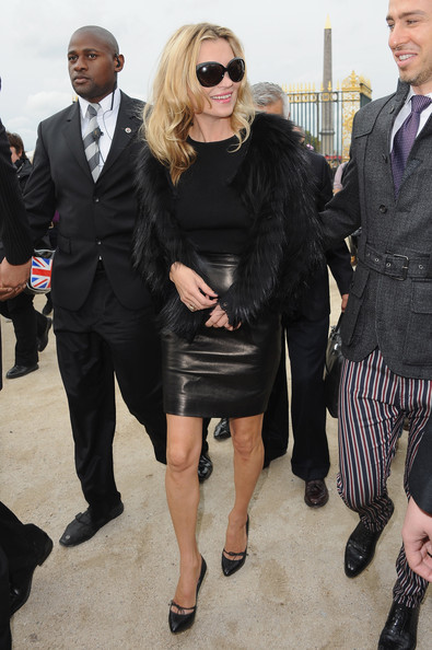 Kate Moss arrives for the Christian Dior Ready to Wear Spring/Summer 2011 show during Paris Fashion Week at Espace Ephemere Tuileries on October 1, 2010 in Paris, France.