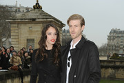 Chelsea Tyler (L) and companion Joe Foster arrive to attend the Christian Dior Fall/Winter 2013 Ready-to-Wear show as part of Paris Fashion Week on March 1, 2013 in Paris, France.
