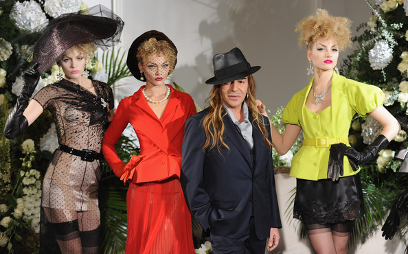 John Galliano Fashion Designer John Galliano poses with models during the Christian Dior Haute Couture fashion show for A/W 2009/10 on July 6, 2009 in Paris, France.