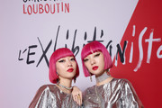 Ami Suzuki and Aya Suzuki aka Amiaya attend the Exhibition Opening of L'Exibition[niste] by Christian Louboutin as part of Paris Fashion Week Womenswear Fall/Winter 2020/2021 on February 24, 2020 in Paris, France.