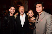 (L-R) Darren Criss, Christian Louboutin, Ashley Weston and Charles Melton attend the Loubicircus Party by Christian Louboutin at Musee des Arts Forains as part of Paris Fashion Week on June 19, 2019 in Paris, France.