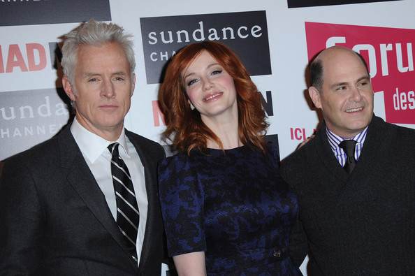 Christina Hendricks Writer/Producer Matthew Weiner (R), actors Christina Hendricks (C) and John Slattery (L)  attend the 'Mad Men' photocall at Forum Des Images on February 9, 2011 in Paris, France.