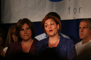 New York City Council Speaker Christine Quinn speaks next to her wife Kim Catullo (L) during her concession speech in the New York Democratic mayoral primary elections on September 10, 2013 in New York City. Quinn, who lead early in the polls and who was endorsed by all of New York's major newspapers, saw her lead slip away in the final weeks of the campaign. Quinn would have been the first woman and lesbian to hold the job of mayor.