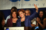 New York City Council Speaker Christine Quinn waves with her wife Kim Catullo (L) while giving her concession speech in the New York Democratic mayoral primary elections on September 10, 2013 in New York City. Quinn, who lead early in the polls and who was endorsed by all of New York's major newspapers, saw her lead slip away in the final weeks of the campaign. Quinn would have been the first woman and lesbian to hold the job of mayor.