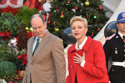 (L-R) Prince Albert II of Monaco, Prince Jacques of Monaco and Princess Charlene Of Monaco attend the annual Christmas gifts distribution at Monaco Palace on December 14, 2016 in Monaco, Monaco.