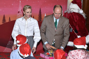 Princess Charlene Of Monaco and Prince Albert II of Monaco attend the annual Christmas gifts distribution at Monaco Palace on December 14, 2016 in Monaco, Monaco.