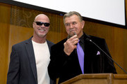 ( L-R) Jim McMahon former Chicago Bear quaterback gets a award from Mike Ditka former Chicago Bears coach at The Christopher and Dana Reeve Foundation dinner at the Peninsula Hotel on October 22, 2015 in Chicago, Illinois.