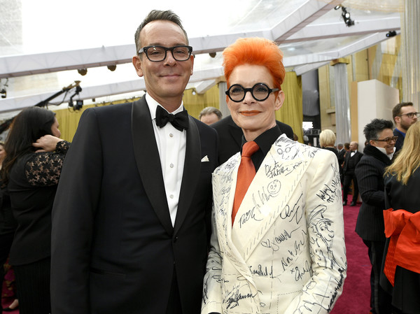 92nd Annual Academy Awards - Red Carpet [red carpet,eyewear,fashion,suit,event,fashion design,glasses,fun,vision care,room,formal wear,christopher peterson,sandy powell,hollywood,california,highland,92nd annual academy awards,christopher peterson,sandy powell,whoopi goldberg,shakespeare in love,hollywood,academy awards,the aviator,dark waters,photograph,livingly media]