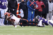 Wide Receiver A.J. Green #18 of the Cincinnati Bengals is tackled after a reception by cornerback Brandon Carr #24 of the Baltimore Ravens in the first quarter at M&T Bank Stadium on December 31, 2017 in Baltimore, Maryland.