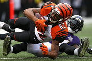 Wide receiver Marvin Jones #82 of the Cincinnati Bengals catches a pass in front of defensive back Kyle Arrington #24 of the Baltimore Ravens in the fourth quarter at M&T Bank Stadium on September 27, 2015 in Baltimore, Maryland.