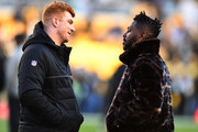 Andy Dalton #14 of the Cincinnati Bengals talks with Antonio Brown #84 of the Pittsburgh Steelers before the game at Heinz Field on December 30, 2018 in Pittsburgh, Pennsylvania.