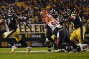 Ben Roethlisberger #7 of the Pittsburgh Steelers scrambles out of the pocket under pressure from Andrew Billings #99 of the Cincinnati Bengals in the fourth quarter during the game at Heinz Field on December 30, 2018 in Pittsburgh, Pennsylvania.