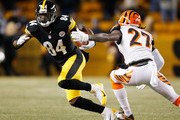 Antonio Brown #84 of the Pittsburgh Steelers tries to get around the tackle of Dre Kirkpatrick #27 of the Cincinnati Bengals after a fist quarter reception at Heinz Field on December 15, 2013 in Pittsburgh, Pennsylvania.