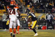 Antonio Brown #84 of the Pittsburgh Steelers catches a 12 yard touchdown pass against the Cincinnati Bengals during the game on December 15, 2013 at Heinz Field in Pittsburgh, Pennsylvania.