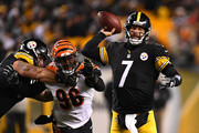 Ben Roethlisberger #7 of the Pittsburgh Steelers drops back to pass under pressure from Carlos Dunlap #96 of the Cincinnati Bengals in the first half during the game at Heinz Field on December 30, 2018 in Pittsburgh, Pennsylvania.