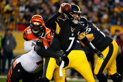 Ben Roethlisberger #7 of the Pittsburgh Steelers is wrapped up for a sack by Christian Ringo #79 of the Cincinnati Bengals in the first half during the game at Heinz Field on December 30, 2018 in Pittsburgh, Pennsylvania.